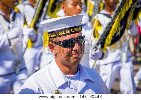 BARRANQUILLA, COLOMBIA - FEBRUARY 15, 2015: Naval academy students participate in Colombia's most important folklore celebration, the Carnival of Barranquilla, Colombia