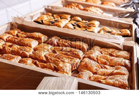 Pastries And Bread In A Bakery. Various Puff Pastry, Croissants, Buns And Pies