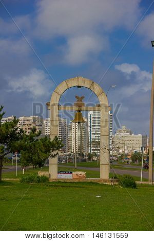 PUNTA DEL ESTE, URUGUAY - MAY 06, 2016: arco de la paz is a small monument located in one of the streets close to the beach.