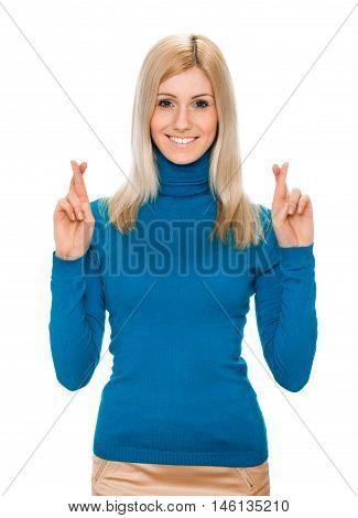 portrait of a young pretty happy woman crossing fingers wishing, praying, christening. isolated on white background. Positive emotions facial expression feelings