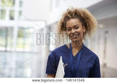 Portrait Of Female Nurse Wearing Scrubs In Hospital