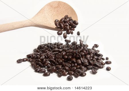 Wooden Spoon Dropping Coffee Beans