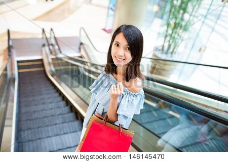 Woman carry shopping bag in shopping center