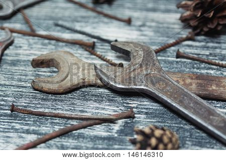 Different tools on a black and white wooden background