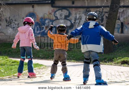 Three Children Roller Blading