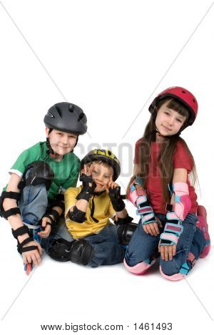 Three Children In Helmets