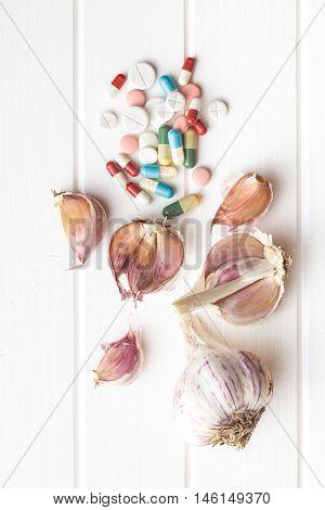 Pills and garlic. Nature antibiotic.