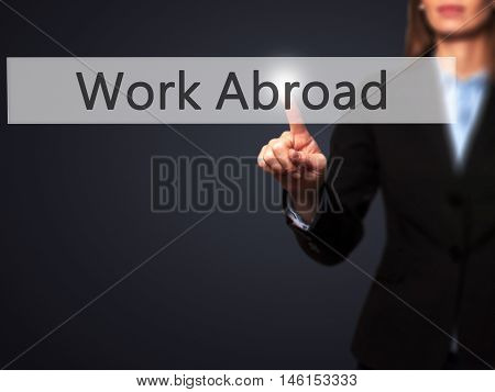 Work Abroad - Businesswoman Hand Pressing Button On Touch Screen Interface.