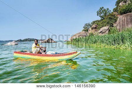 Mwanza,Tanzania,Africa- March 26. 2016: African Man transporting goods on the boat on lake Victoria in Mwanza Tanzania