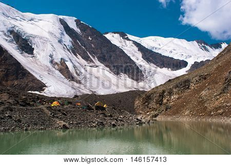 Emerald Lake With White Snow Peaks