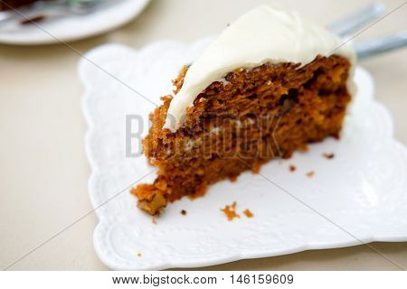 Sweet slice cake on white plate. Shallow depth of field.