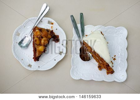 Sweet slice cake on white plate. Top view