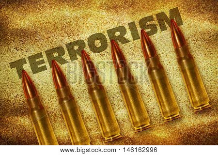 Six shiny bullets and word Terrorism on grunge background