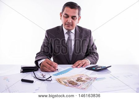 indian man planning monthly bidget or account expenses