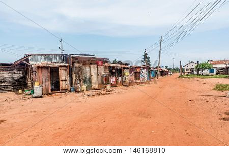 Bukoba,Tanzania- March 28, 2016: Dirt road with stores and houses in Bukoba Tanzania