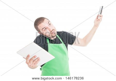Market Employee Being Busy Multitasking With Tablet And Phones