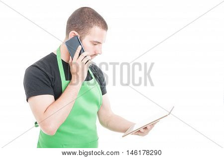 Young Employee Holding Tablet And Speaking At Phone
