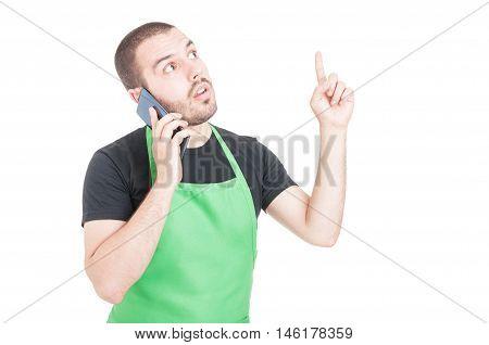Handsome Supermarket Employee Making Great Idea Gesture At Phone