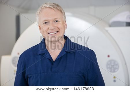 Medical Professional Smiling Against MRI Scanner