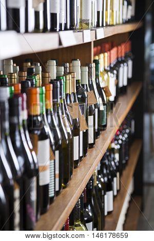 Wine Bottles Displayed On Shelves
