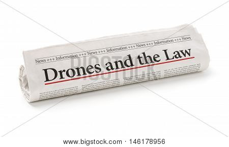 Rolled Newspaper With The Headline Drones And The Law