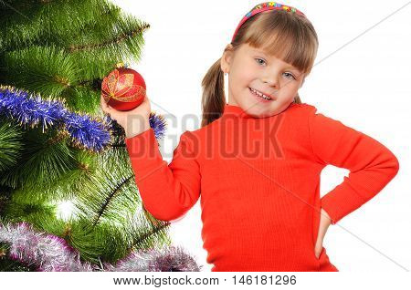 Little girl decorates a fur-tree. Isolated on the white