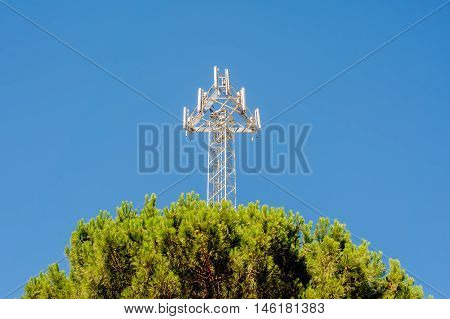The transmitter of cellular communication on a background of the blue sky