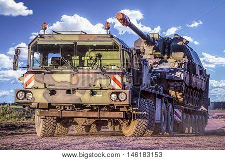 german heavy duty tank transporter transports a german tank