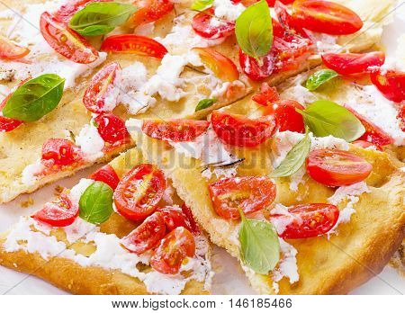 Italian Focaccia With Tomatoes, Cream Cheese And Basil Leaves