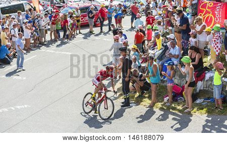 Col du Glandon France - July 23 2015: The Spanish cyclist Luis Angel Mate Mardones of Cofidis Team riding in a beautiful curve at Col du Glandon in Alps during the stage 18 of Le Tour de France 2015.