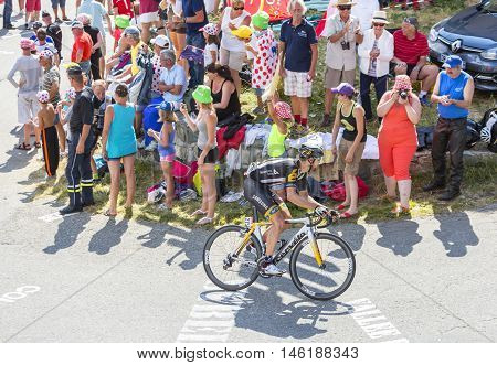 Col du Glandon France - July 23 2015: The South African cyclist Reinardt Janse van Rensburg of MTN-Qhubeka Team riding in a beautiful curve at Col du Glandon in Alps during the stage 18 of Le Tour de France 2015.