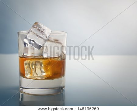 Whisky Glass With Ice Cubes Studio Shot