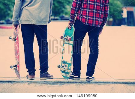 Skater Boys Standing On A Ramp In Skate Park