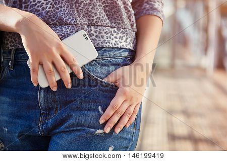Girl Holding Modern Dual Camera Smart Phone In Hand