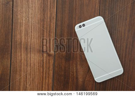 Modern Dual Rear Camera Smart Mobile Phone On Wooden Surface