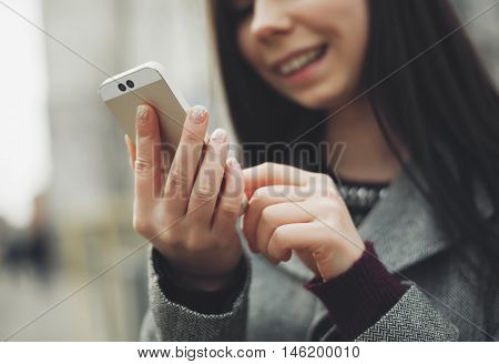 Girl Using Modern Smart Phone With Dual Camera