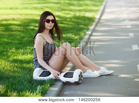 Girl With Electric Mini Hover Board Scooter In Park