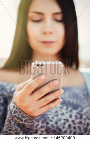 Brunette Young Girl Using Big Silver Modern Smart Phone