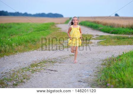 beautiful girl running on lonely rural road