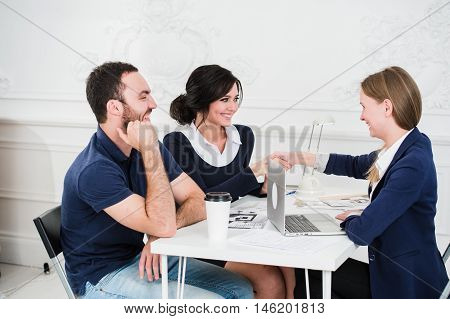 Young couple meeting architect for future house.