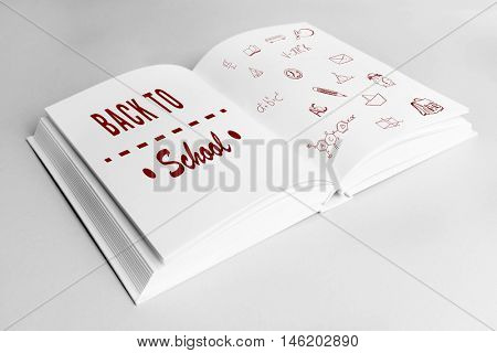 Book with icons on white background. Text back to school on page.