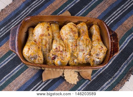 Baked Chicken Legs In A Clay Plate.