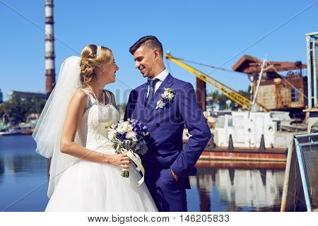Bride and groom wedding photo shoot in the port. Bride and groom on a romantic moment.