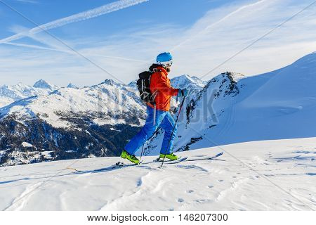 Ski touring in high mountains in fresh powder snow. Snow mountain range. Mt Fort Peak Alps region Switzerland.Wallis