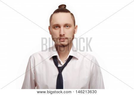 Portrait of young man in white shirt on white background. Man with beard in white shirt and loosened his tie