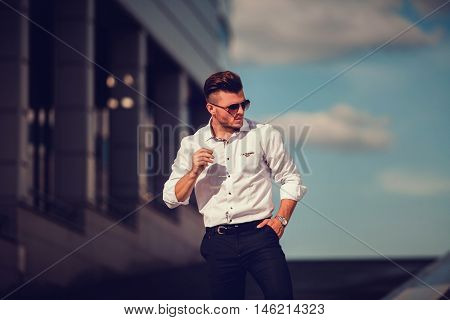 Elegant young handsome business man wearing glasses and watchers