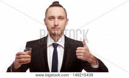 Half shaved. Handsome young man with half shaved face. Half shaven young man holding a glass with alcohol shows Like