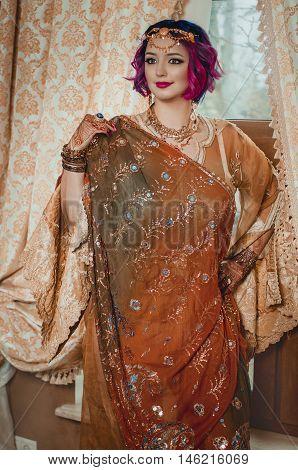 Beautiful Indian Woman In A Yellow Sari