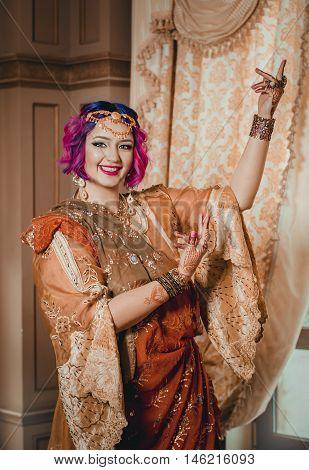 Beautiful Indian Woman In A Yellow Sari Dancing Traditional Bhar