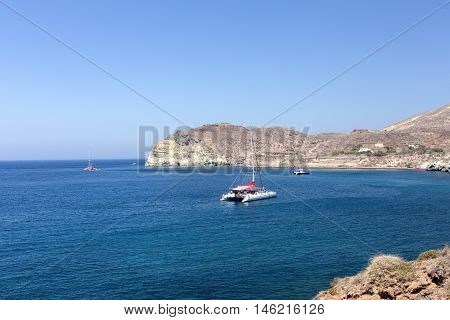 the catamaran in the blue lagoon on a mountain background
